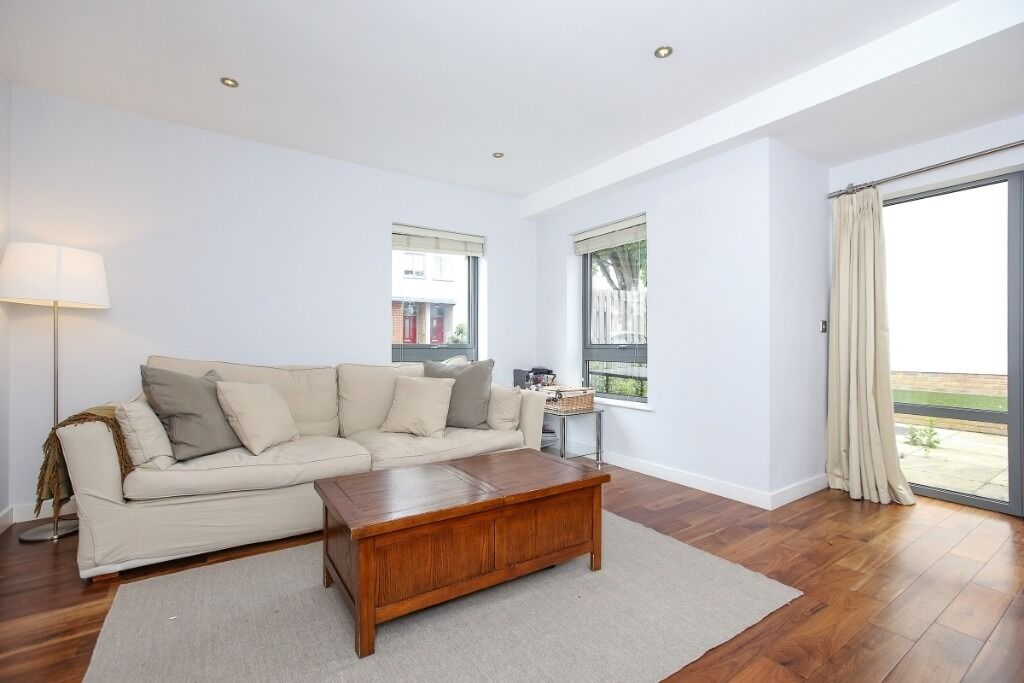 A stunning three double bedroom town house offering a private patio garden, Elbe Street, SW6