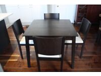Dark wood square dining table and four chairs