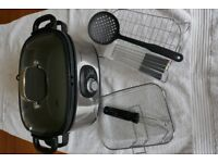 Electric multi cooker - slow cooking, steaming, roasting and deep-frying all in one device
