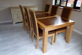 High Quality solid light oak table with dark wood panels and 6 matching chairs