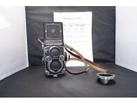 Rolleiflex 3.5f. 120 film Camera with. New Lens Hood, New Strap. Manual ,Lens Caps.
