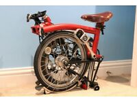Red Brompton folding bike, M3L 2012 model. Well cared for, and recently serviced.