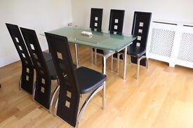 Extendable glass dining table and faux leather black chairs