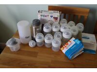 Huge bundle of Natural Avent Bottles,Tommie Tippie travel warmer & Munchkin Latch Steriliser Bags
