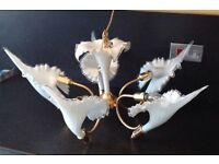 A unique and beautiful sea shell glass chandelier.... Fantastic for any room ....in good condition
