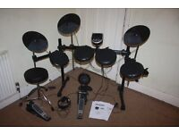 Alesis DM6 Electronic Drum Kit including Stool + Headphones + Drum Sticks