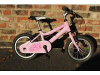 Ridgeback Honey bike. Pink with 14 inch wheels. Used (but not a lot) and in great condition.