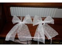 Large white bows for decoration
