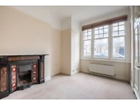 A spacious UNFURNISHED ground floor two bedroom flat
