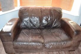 Two used brown leather sofas for sale