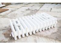 Acova Classic steel column radiators with timeless 4-column design.