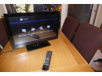 22 INCH FREEVIEW LED TV WITH 2 HDMI, FULL GLOSS FINISH FRONT PANEL AND GLASS STAND