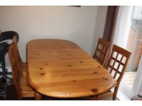 Pine kitchen table & 4 chairs. Extends to seat 8 comfortably