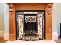 Tiled Victorian-style cast iron fireplace