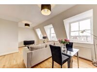 Lexham Gardens W8. A two bed stucco fronted building on a classic Kensington street.