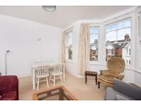 A first floor period one double bedroom conversion flat to rent in sought after Southfields grid.