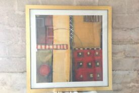 Modern abstract print in a gold frame with glass