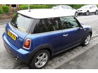 Mint condition low mileage Mini Cooper 1.6 Hatchback. Metallic blue with sought after white roof.