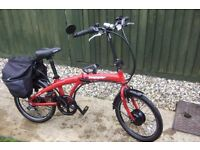 Fold up electric bike. Not used much. not even 2 years old.