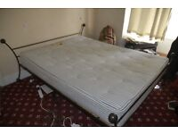Kingsize bed and mattress . hand made and solid steel frame . good quality .