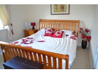 Super King Size bed with chest of drawers and 2 bedside tables