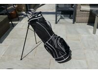 Set of golf clubs and new carry bag