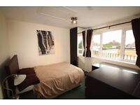 A spacious double bedroom situated within a shared 1st floor flat close to Oakwood station & shops