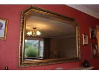 MUST GO: large gold-framed wall mirror