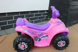 Evo 6v Electric Ride on quad pink with charger. RRP Tesco £48 so this is a real bargain!
