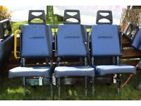 Seating for a minibus. 3 in a row attached to frame and 4 freestanding. Good condition.
