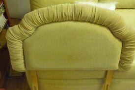 Single bed upholstered headboard in beige fabric.