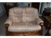 Three seater and two seater leather settees with matching side table