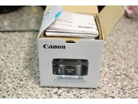 Brand New Canon Lens with Hood (in box)