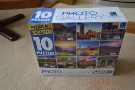 box of 10 jigsaws - pieces vary from 300-1000