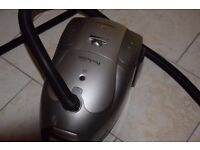 Vacuum cleaner with hose and tools, Silver Black. Excellent condition.