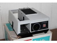 Hanimex slide projector, a screen and 10 slide caddies