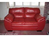 Red leather two seater settee in excellent condition