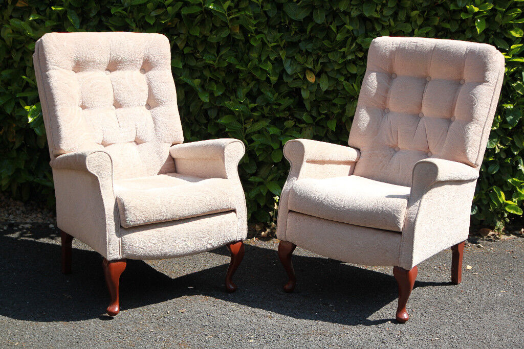 A pair of cream high seat chairs