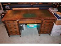 Pedestal Desk with leather top.
