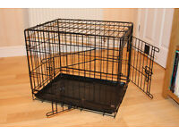 Dog crate ( small ) as new ,hardly used. 2 doors. Collapsable