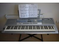 Electric Keyboard: Yamaha DGX-200 Portable Grand, 72 key, with FREE SHEET MUSIC