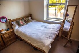 A large double bedroom in a characterful house off lark Lane