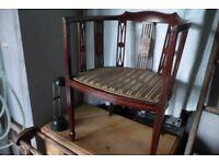 Vintage charm: An antique Thomas Sheraton-designed tub chair.
