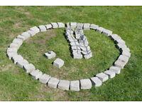 Around 50 Grey garden edging cast stones