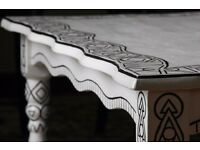 refurbished white coffee table with hand painted black geometric shapes and patterns