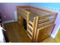 Solid wood cabin bed, as new condition with built in desk plus cupboard and shelves