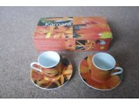Four Porcelain Espresso Cup and Saucer Sets