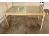 Glass table with wooden frame