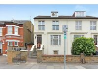 Large studio flat in Wimbledon. Heating and water rates included.