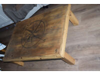 Solid wood coffee table with compass engraving